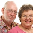 Happy Senior Couple Pose For A Portrait - Stock Photo