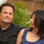 Hispanic and Caucasian Couple on the Patio — Stock Photo