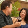 Royalty-Free Stock Photo: Attractive Hispanic and Caucasian Couple Toasting