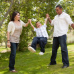 Hispanic Man, Woman and Child Having Fun — Stock Photo