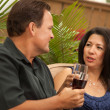 Attractive Hispanic and Caucasian Couple Drinking Wine — Stock Photo