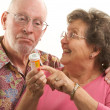 Foto Stock: Senior Couple With Prescription Bottle