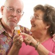 Stok fotoğraf: Senior Couple With Prescription Bottle