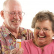 Senior Couple With A Prescription Bottle — Stock Photo