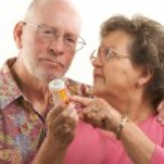 Senior Couple With A Prescription Bottle — Stock Photo