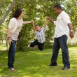 Hispanic Man, Woman and Child in Park — Stock Photo #2348947
