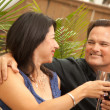 Royalty-Free Stock Photo: Smiling Hispanic and Caucasian Couple Drinking Wine