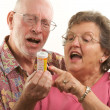 Senior Couple With A Prescription Bottle -  