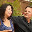 Stock Photo: Happy Hispanic and CaucasiCouple Socializing
