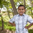 Handsome Young Hispanic Boy Having Fun i - Photo