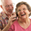 Senior Couple Using Cell Phone on White — Stock Photo