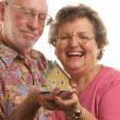 Happy Senior Couple Holding a Model Home — Stock Photo