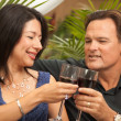 Attractive Hispanic and Caucasian Couple Drinking Wine — Stock Photo #2349201