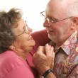 Happy Senior Couple Dancing - Stock Photo