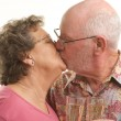 Senior Couple with Champagne Kissing — Stock Photo #2349293