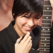 Multiethnic Girl Poses with Her Guitar — Stock Photo