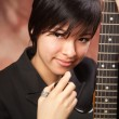 Multiethnic Girl Poses with Her Guitar - Stock Photo