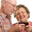 Royalty-Free Stock Photo: Happy Senior Couple Toasting Wine