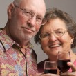 Stock Photo: Happy Senior Couple Toasting Wine