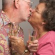 Senior Couple with Champagne Kissing — Stock Photo