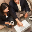 Man and Woman Using Laptop with Coffee — Stock Photo