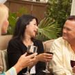 Three Friends Enjoying Wine on Patio - Foto Stock