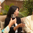 Stock Photo: Three Friends Enjoying Wine on Patio