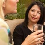 Two Girlfriends Enjoy Wine on Patio — Stock Photo #2349916