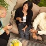 Three Friends Enjoying Wine on Patio — Stock Photo #2349952
