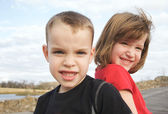 Two Children Smile for Camera at Park — Stock Photo