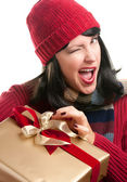 Winking Woman Holds Holiday Gift — Stock Photo