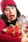 Nervous Woman Balances Many Gifts — Stock Photo