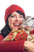 Smiling Woman Holds Holiday Gifts — Stock Photo