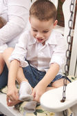 Adorable Young Boy Getting Dressed — Stock Photo