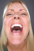 Laughing Blond Woman with Funny Face — Stock Photo