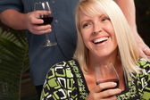 Wine Drinking Blonde Socializes at party — Stock Photo