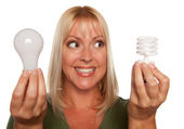 Woman Holds Energy Saving and Regular Light Bulb — Stock Photo