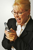 Excited Businesswoman on Cell Phone — Stock Photo
