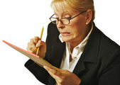 Female Erases Mistake on her Notepad — Stock Photo