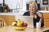 Woman Using Laptop for E-commerce — Stock Photo