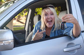 Excited Girl In New Car with Keys — Stock Photo