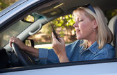 Blonde Girl Texting While Driving — Stock Photo