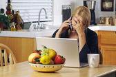 Stressed Woman Using Phone and Laptop — Stock Photo