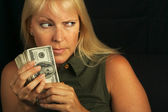 Stingy Blonde Protects Her Cash — Stock Photo