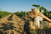 Blonde Woman Strolling Thru a Vineyard — Stock Photo
