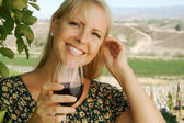 Beautiful Woman Sips Wine in Vienyard — Stock Photo