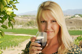Attractive Girl Sips Wine at Vineyard — Stock Photo