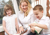 Young Brother and Sister Reads Books with Mom — Stock Photo