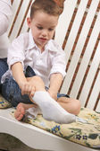 Young Boy Getting Dressed Putting His Socks — Stock Photo