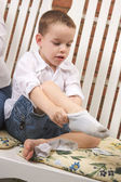 Adorable Young Boy Getting Dressed Putting His Socks On — Stock Photo